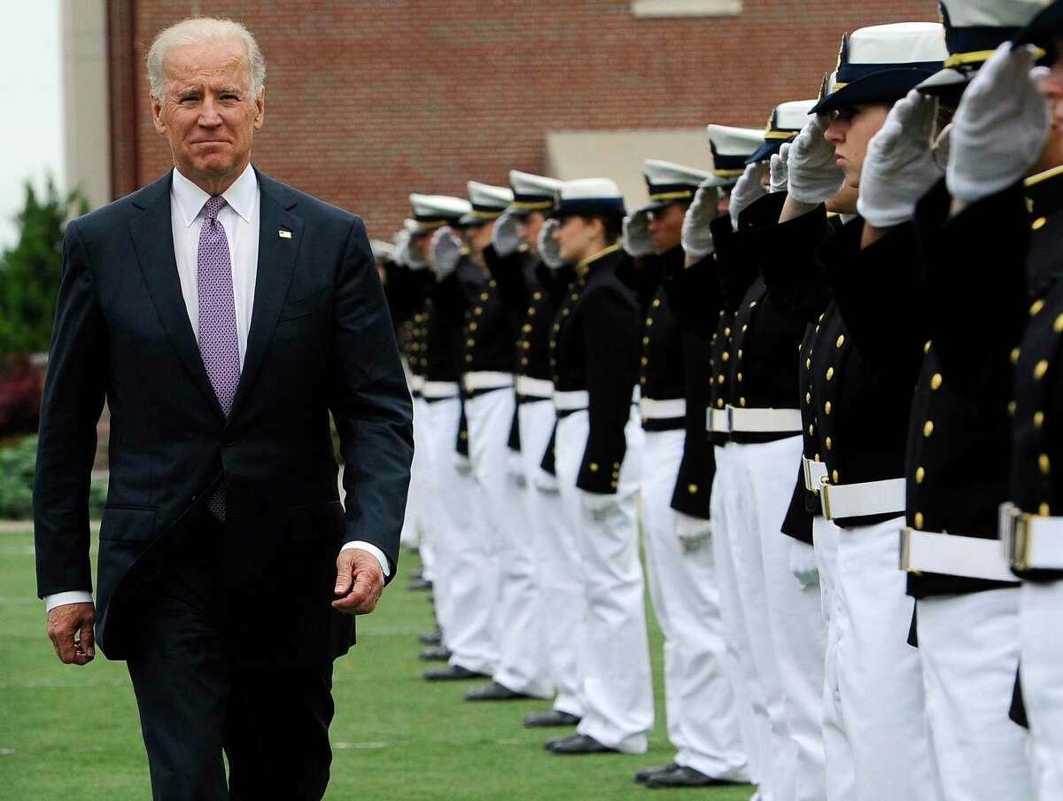 Vice President Joe Biden walks between saluting cadets during commencement for the United States Coast Guard Academy in New London, Conn., Wednesday, May 22, 2013. The vice president told graduating cadet that the nation will increasingly rely on the service for missions including more remote Arctic operations, port security and support of other U.S. military branches in securing maritime shipping around the world. (AP Photo/Jessica Hill)