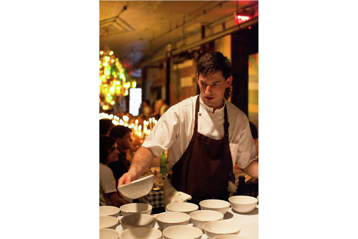 Blaine Wetzel, chef at the Willows Inn on Washington's Lummi Island, prepares dishes in New York in September 2011. A recent New York Times investigation detailed allegations of abuse at the restaurant under his watch.
