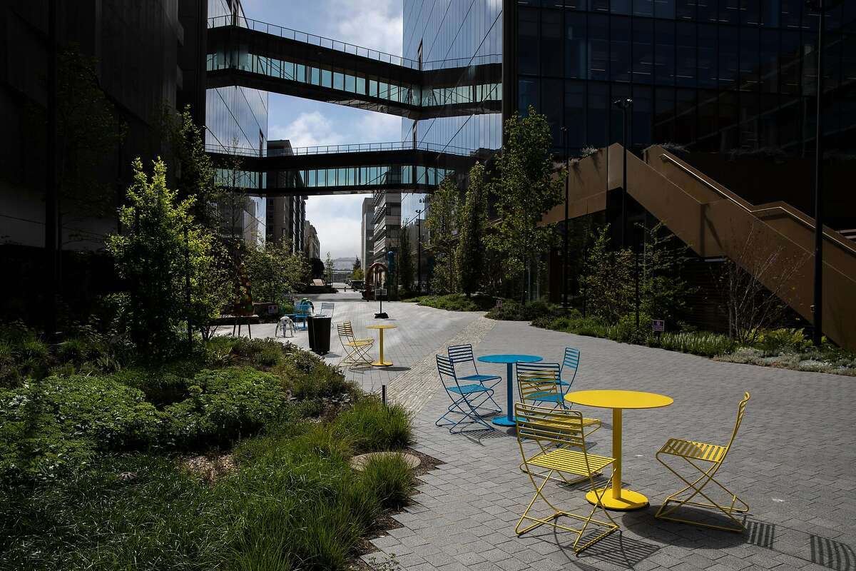 Colorful tables and chairs line Pierpoint Lane between Third Street and Bridgeview Way at Uber's new headquarters.