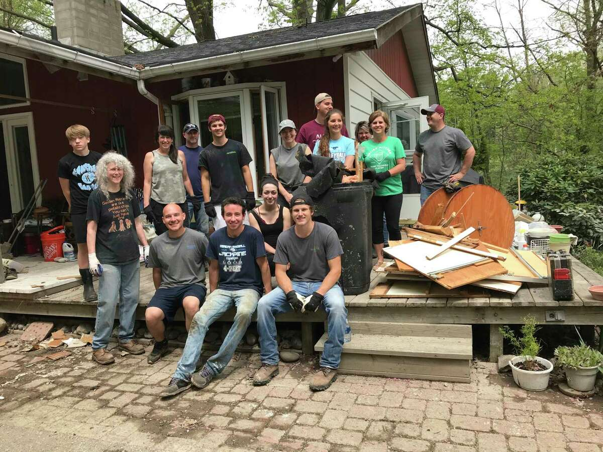 Linda and Wayne Allen, of Sanford, reported that so many people the couple didn't know just began showing up to help them muck out mud and debris, strip down drywall, pull up flooring, and haul things away.