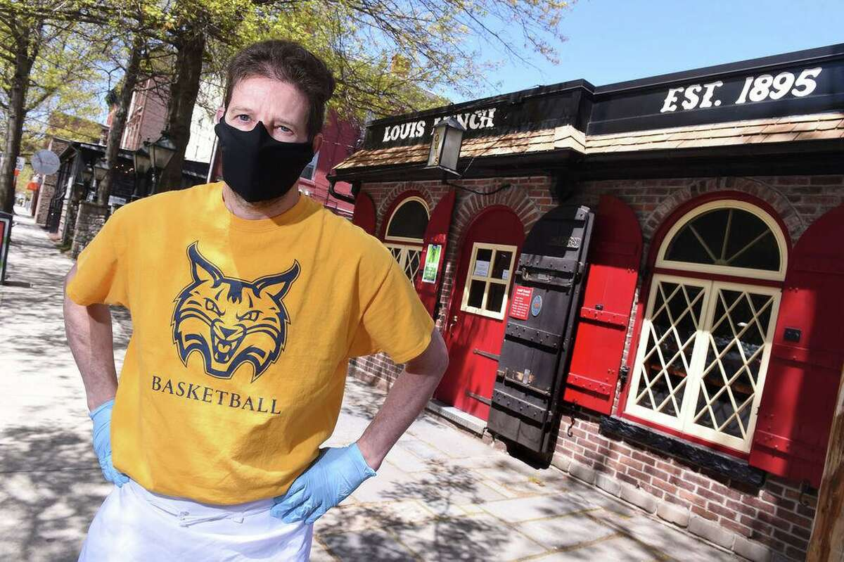 Fourth generation owner of Louis' Lunch Jeff Lassen is photographed outside of the hamburger joint in New Haven on May 13, 2020. The fast-food restaurant is open for take-out.