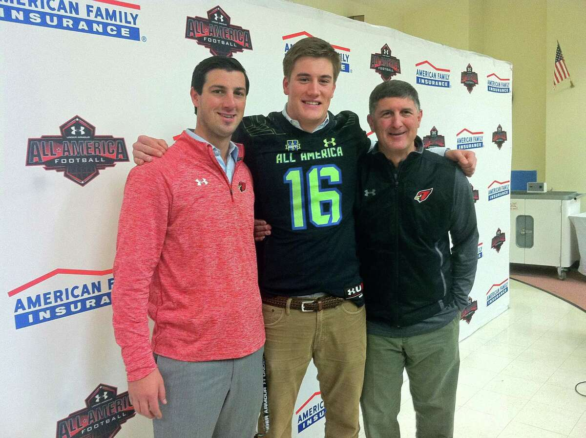 Greenwich High School senior Scooter Harrington, center, stands with Cardinals football coach John Marinelli, left, and Greenwich athletic director Gus Lindine at a recent press conference. Harrington was selected to play in the Under Armour All-America Football Game on Jan. 2 in Orlando, Fla.