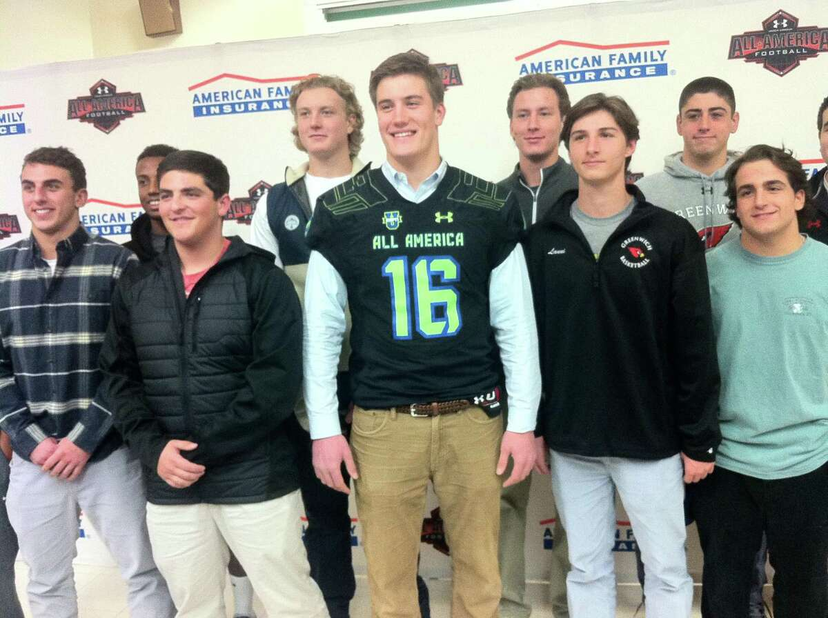 Scooter Harrington, center, poses with some of his Greenwich High School football teammates during Wednesdayís press conference at Greenwich High School. The press conference announced Harringtonís selection to the 2016 Under Armour All-America High School Football Game.