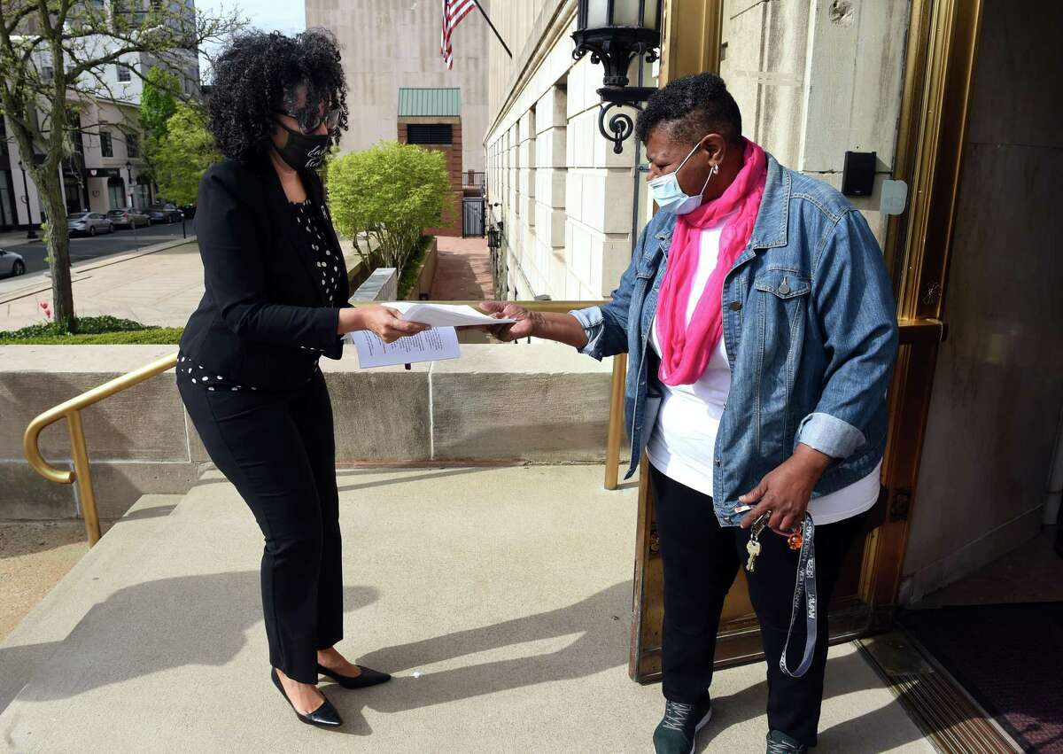 Karen DuBois-Walton, left, drops off paperwork to run for mayor with Deputy City Clerk May Gardner-Reed in front of the Hall of Records in New Haven on May 3, 2021.