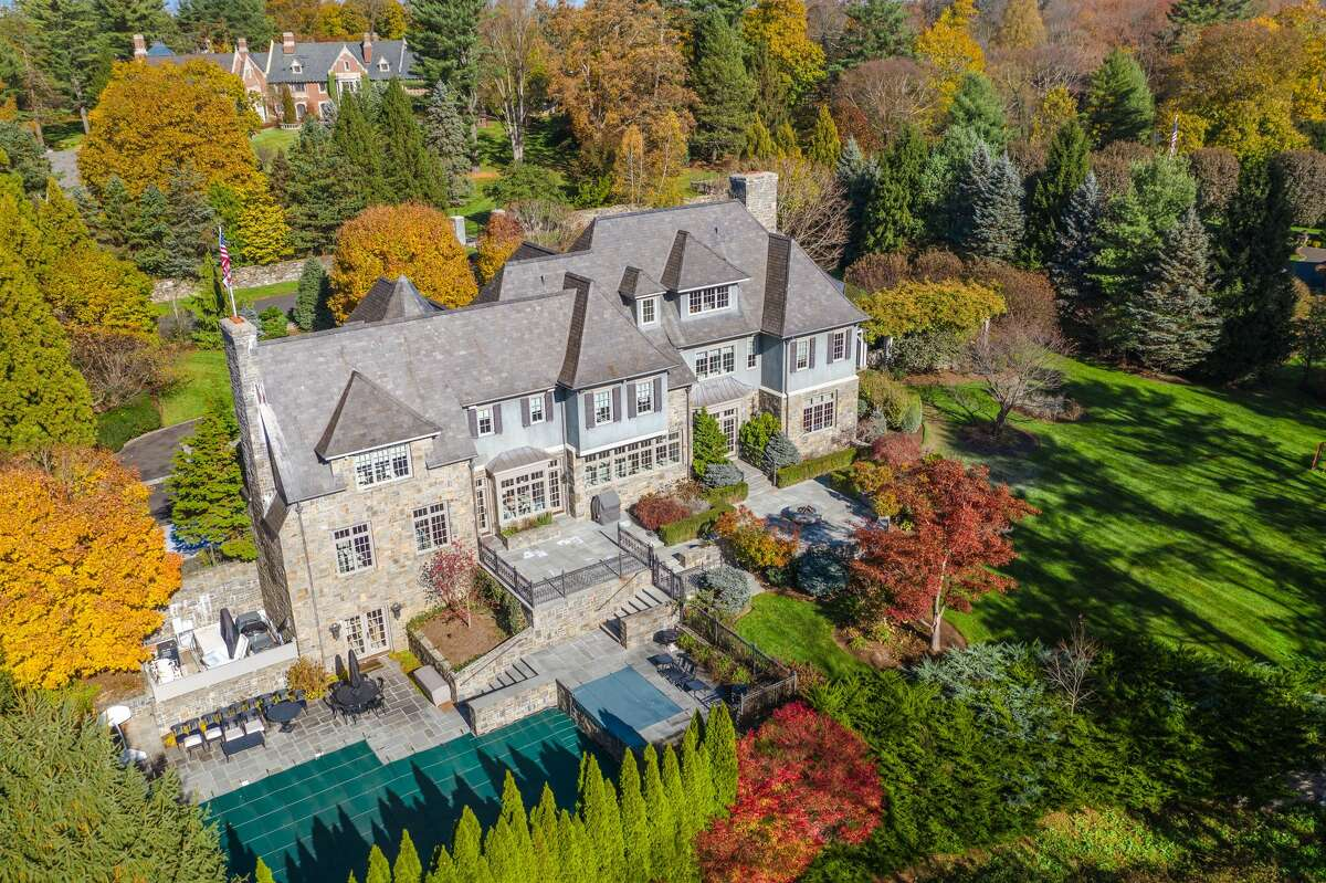 Multiple terraces, patios and swimming pool at 36 Hemlock Hill Road, New Canaan.