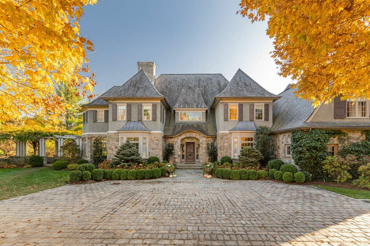 Stone and stucco French Normandy-style colonial house at 36 Hemlock Hill Road, New Canaan.