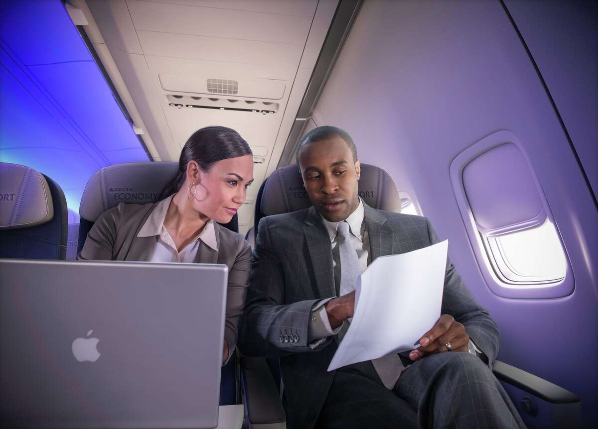 Business travelers in Economy Comfort in a Boeing 757-200ER (75S).