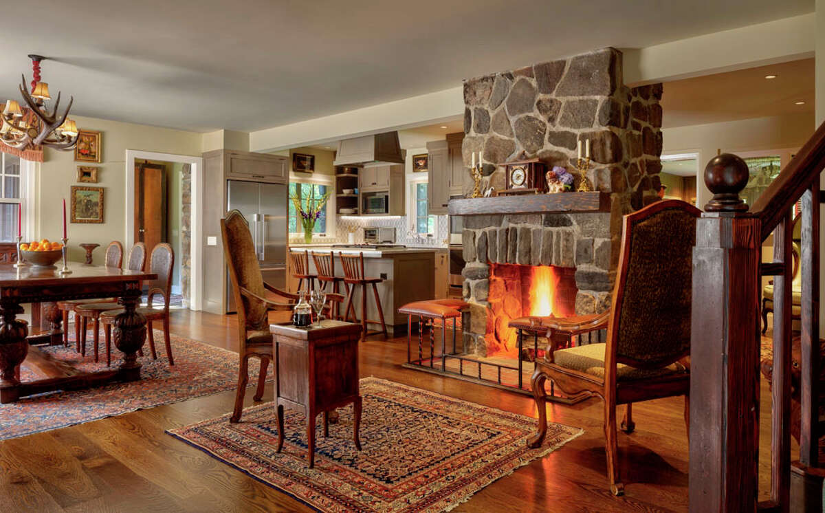 Open floor plan with fireplace at 38 Glen Hill Road, Redding.