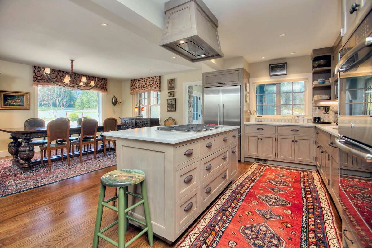 Kitchen open to the dining room at 38 Glen Hill Road, Redding.