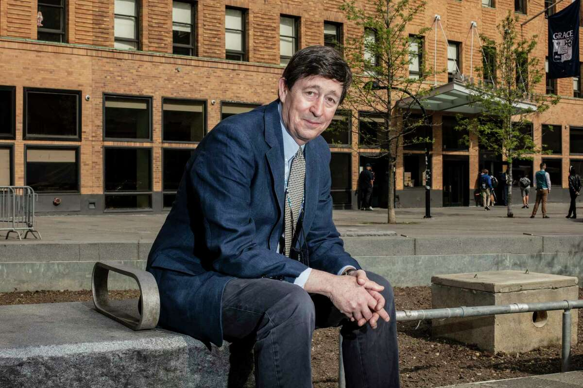 Head of School George Davidson poses for a portrait in front of Grace Church School in New York City on April 28,
