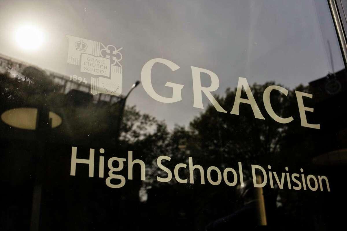 A sign on a window of Grace Church School.