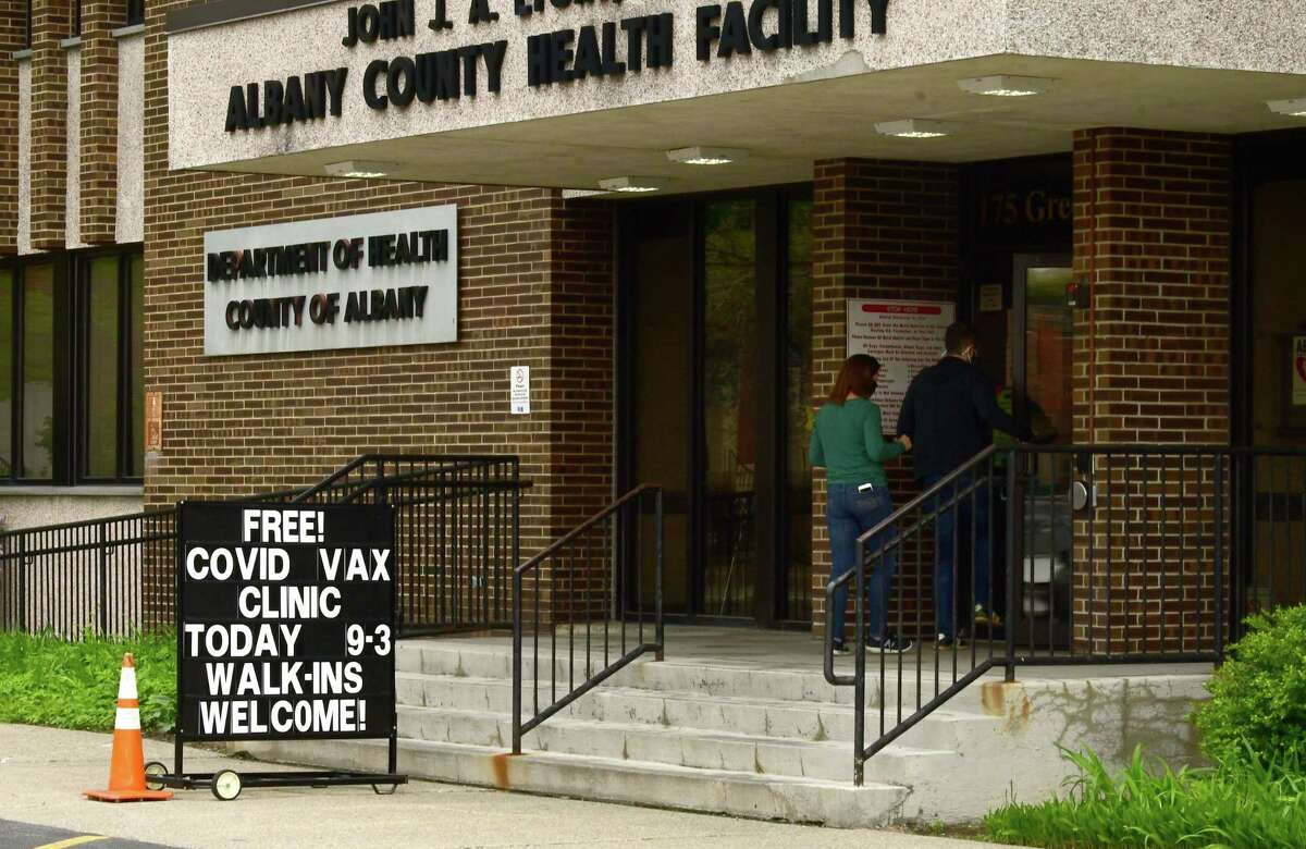 People walk into the County Department of Health at 175 Green St. during a free COVID-19 vaccine clinic on Monday, May 3, 2021 in Albany, N.Y. (Lori Van Buren/Times Union)