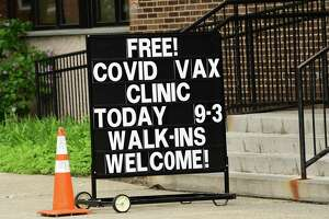 A sign is seen outside the County Department of Health at 175 Green St. during a free COVID-19 vaccine clinic on Monday, May 3, 2021 in Albany, N.Y. (Lori Van Buren/Times Union)
