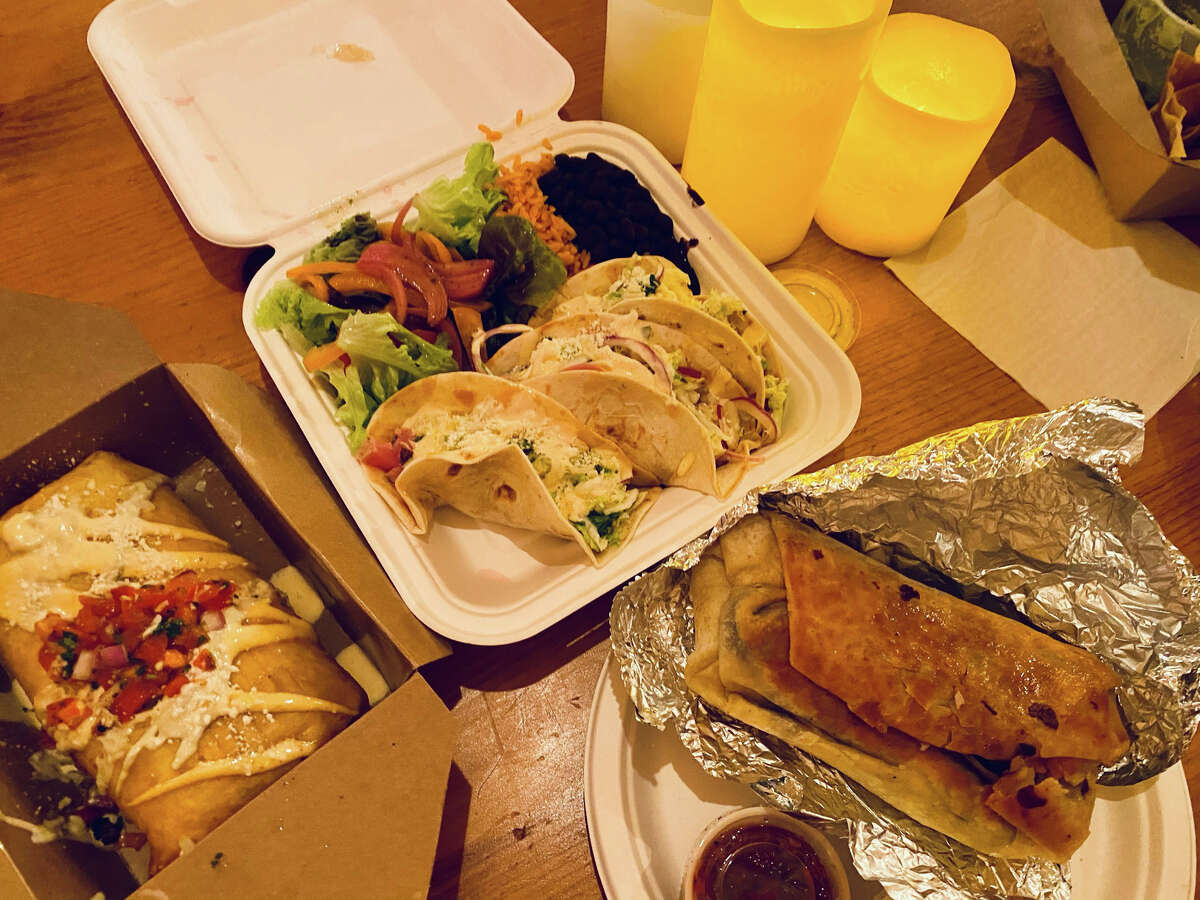 Food including, from left, chimichangas, tacos and burritos are served in takeout containers at Norte Azul Cantina in Stephentown. (Susie Davidson Powell/For the Times Union.)