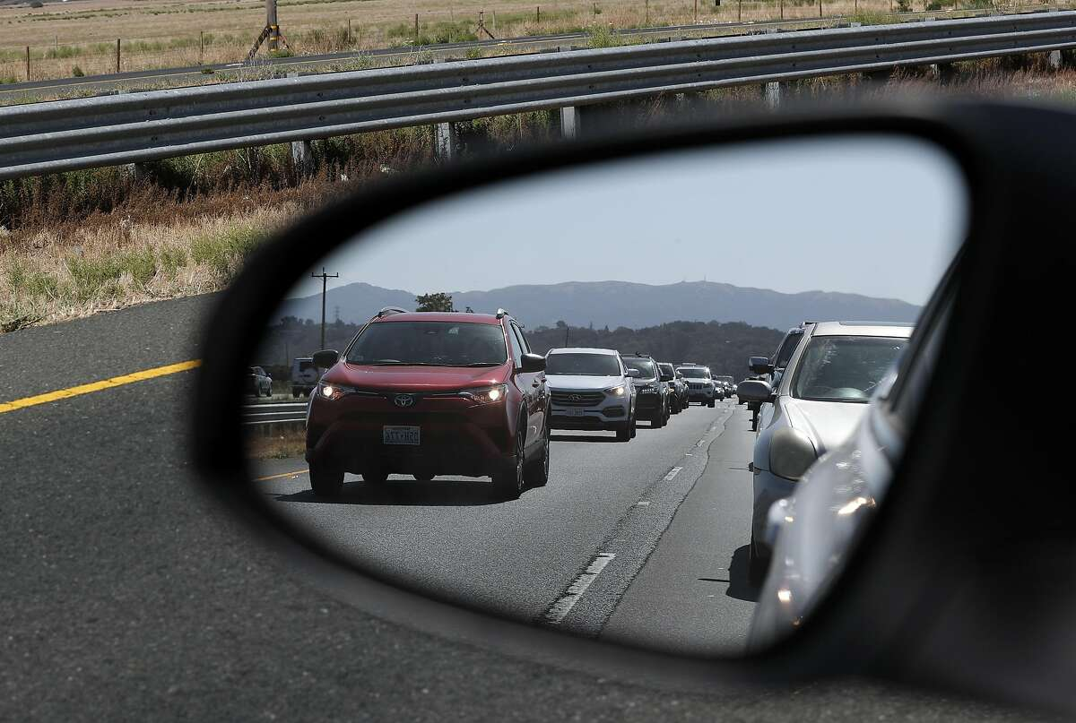 A shot of traffic in a rearview mirror along Highway 37 near Lakeville Road outside Port Sonoma Marina in Novato , Calif., on Friday, September 15, 2017. Traffic was tied up because of an accident at Lakeville Road and those leaving Sonoma Raceway, but the traffic remains jammed regularly.