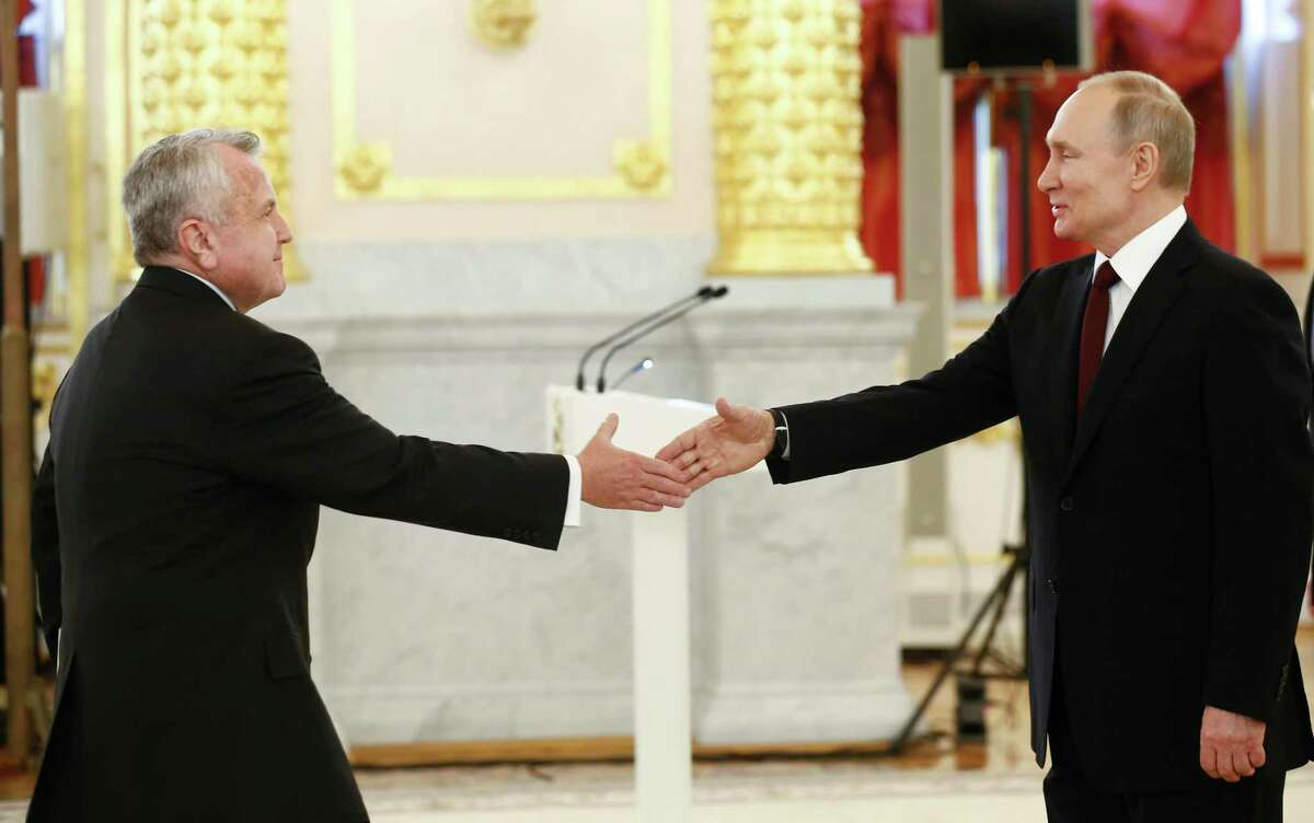 U.S. Ambassador to Russia John Sullivan, left, shakes hands with Russian President Vladimir Putin at a ceremony in Moscow earlier this year. The U.S. must support its ambassdors with the resources and personnel to meet the modern demands of word leadership.