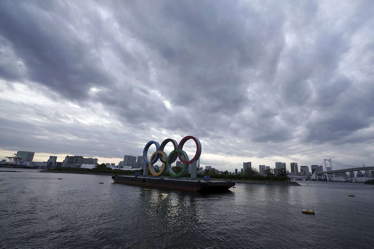 FILE - This April 12, 2021, file photo shows the Olympic rings floating in the water in the Odaiba section in Tokyo. Some nurses in Japan are incensed at a request from Tokyo Olympic organizers to have 500 of them dispatched to help out with the games. They say they're already near the breaking point dealing with the coronavirus pandemic. A protest message saying that nurses were opposed to holding the Olympic went viral on Japanese Twitter recently, being retweeted hundreds of thousands of times. (AP Photo/Eugene Hoshiko, File)