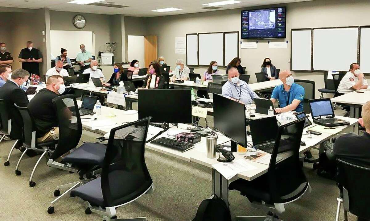 Representatives from community groups and volunteers meet at the emergency operations center (EOC) for planning and logistics support on Thursday, May 21, 2020. (Photo provided/Chris Coughlin)