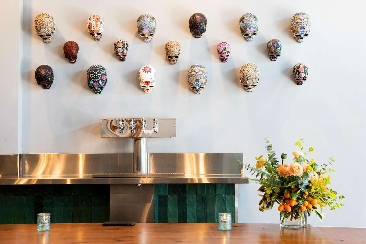 Intricately decorated skulls hang over the bar area at Otra, a new Mexican restaurant in the Haight-Ashbury neighborhood of S.F.