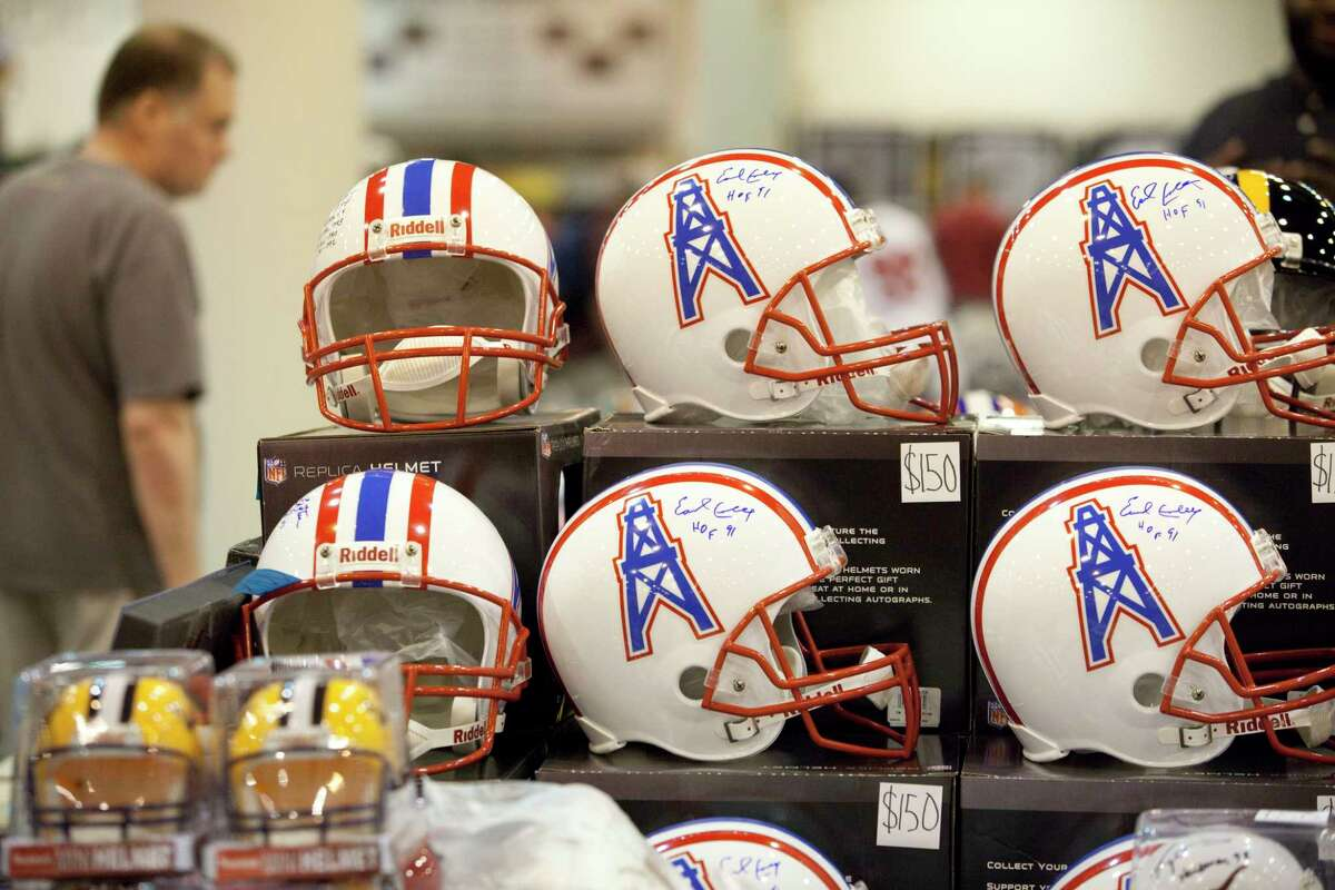 Signed Houston Oiler helmets for sale at the Tristar Card Show June 1, 2013 in Houston at the Reliant Center.