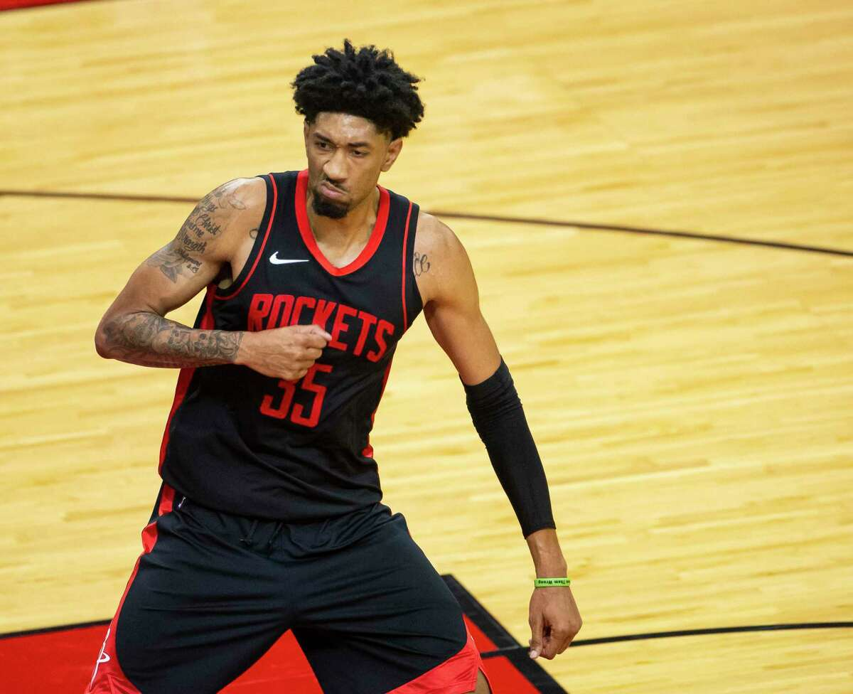 Christian Wood, celebrating a shot against Milwaukee, is key to Rockets' future at center and power forward but not small forward.