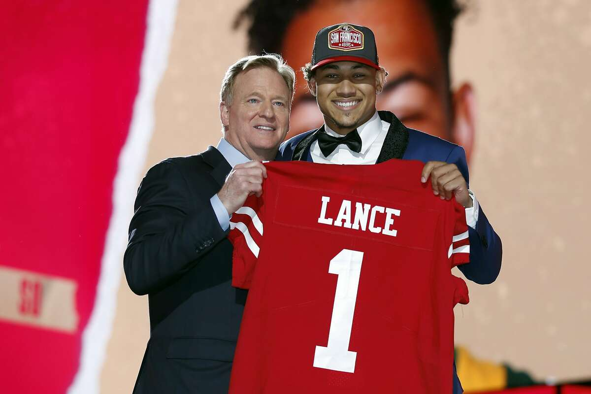 North Dakota State quarterback Trey Lance, right, holds a jersey with NFL Commissioner Roger Goodell after being chosen by the San Francisco 49ers with the third pick in the first round Thursday.