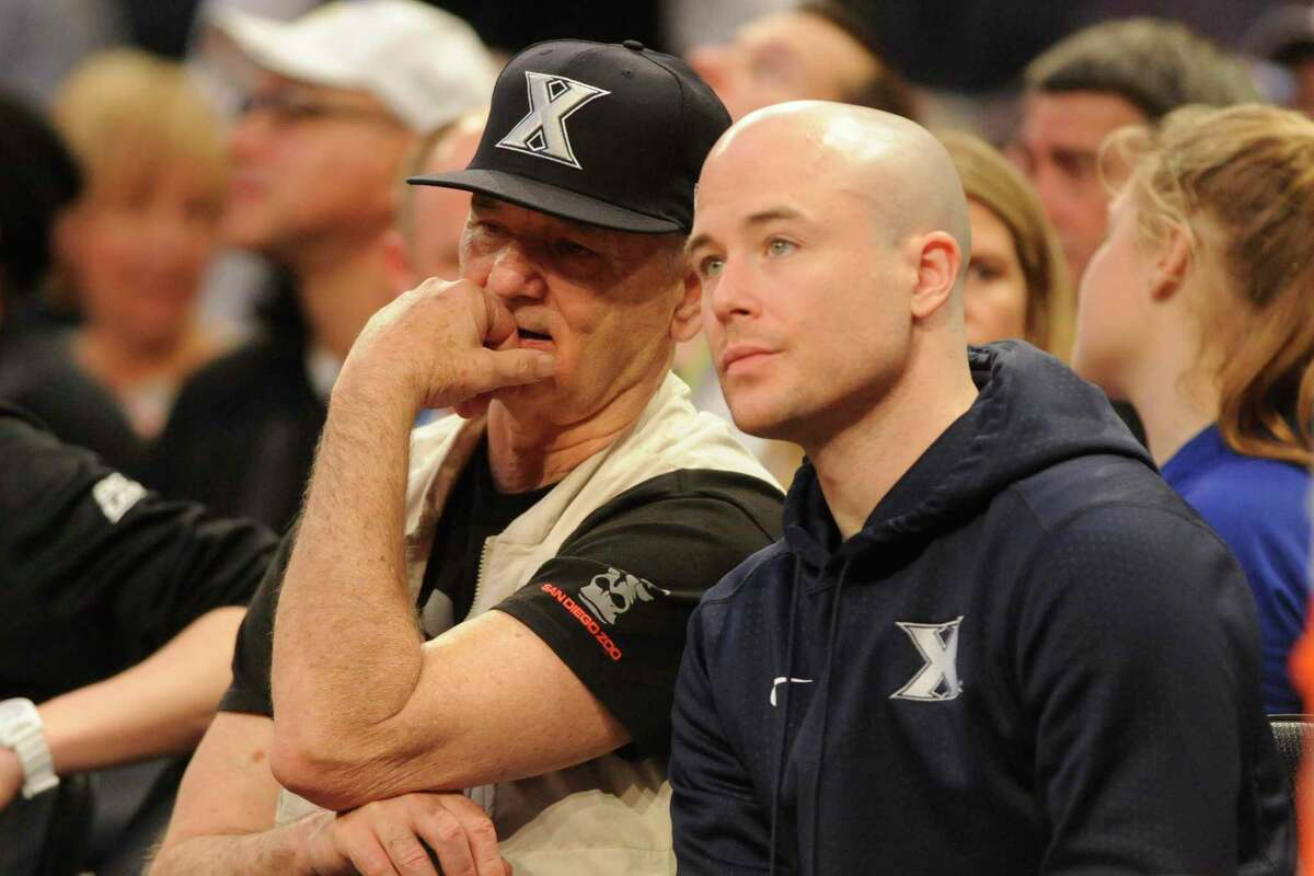 Bill Murray with son Luke Murray, assistant coach of Xavier, watch a quarterfinal game of the Big East College Basketball Tournament between the Seton Hall Pirates and the Creighton Bluejays at Madison Square Garden on March 10, 2016 in New York.