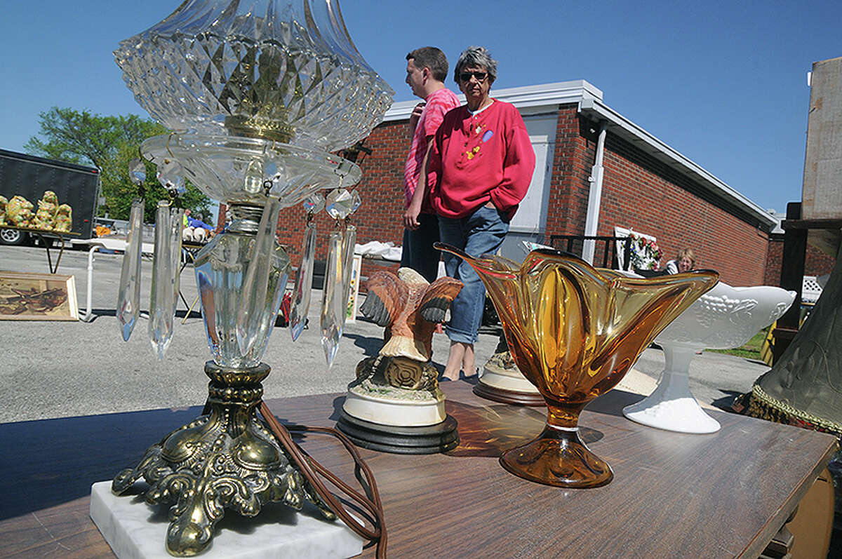 Caleb and Priscilla Lane of Dow view some of the eclectic items for sale at a flea market in Dow.