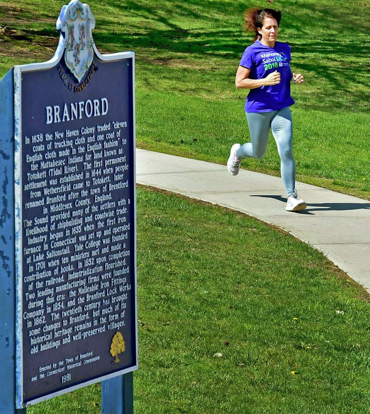 Kellie Boni, of North Branford, running towards Town Hall Drive in Branford, is participating in a nationwide challenge called CityStrides to run or walk every street. She has run every street in North Branford and Northford and has almost competed Branford.