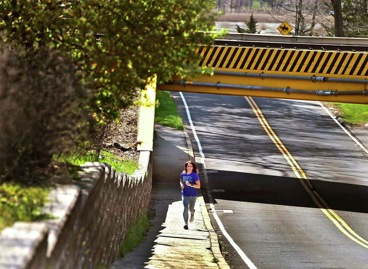 Kellie Boni, of North Branford, running up Montowese Street in Branford, is participating in a nationwide challenge called CityStrides to run or walk every street. She has run every street in No. Branford and Northford and has almost competed Branford.