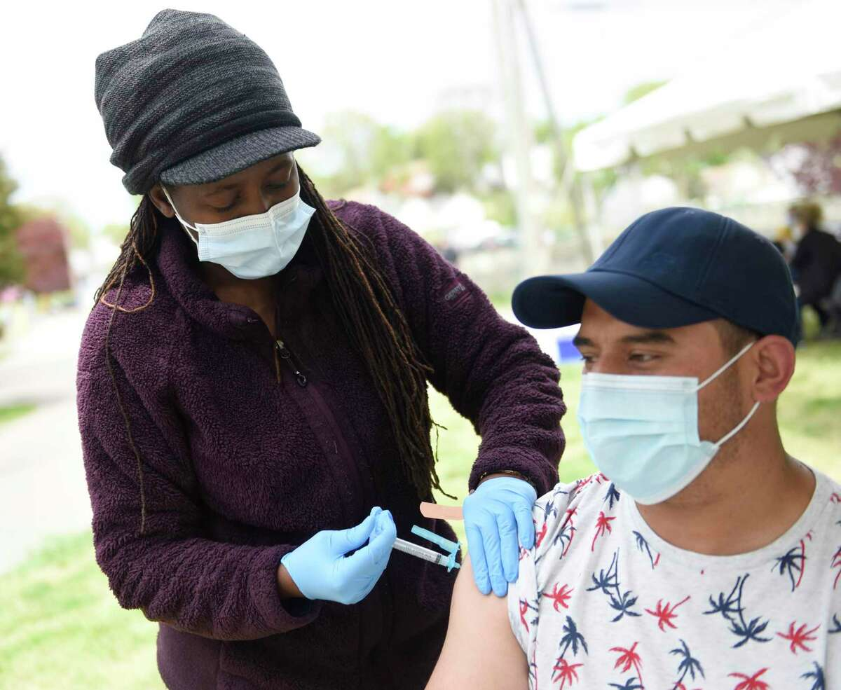 Stamford's Diego Carmona gets vaccinated by Fifi Zinhema, RN, at the Community Health Centers walk-in COVID-19 vaccination clinic at Cove Island Park in Stamford, Conn. Sunday, May 2, 2021. CCH provided patients with the single-dose Johnson & Johnson vaccine Sunday with no appointment necessary.