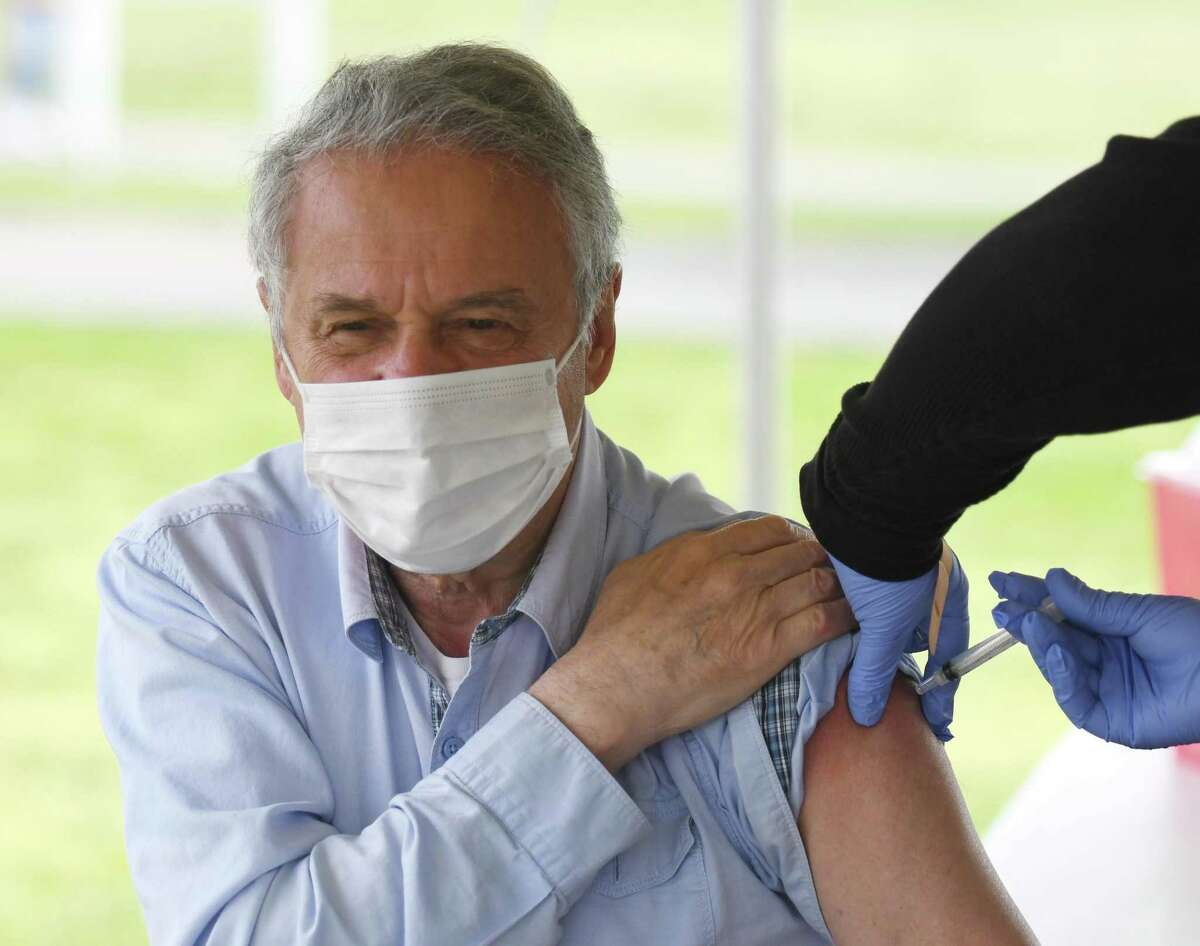 Stamford's Lev Sakin gets vaccinated at the Community Health Centers walk-in COVID-19 vaccination clinic at Cove Island Park in Stamford, Conn. Sunday, May 2, 2021. CCH provided patients with the single-dose Johnson & Johnson vaccine Sunday with no appointment necessary.