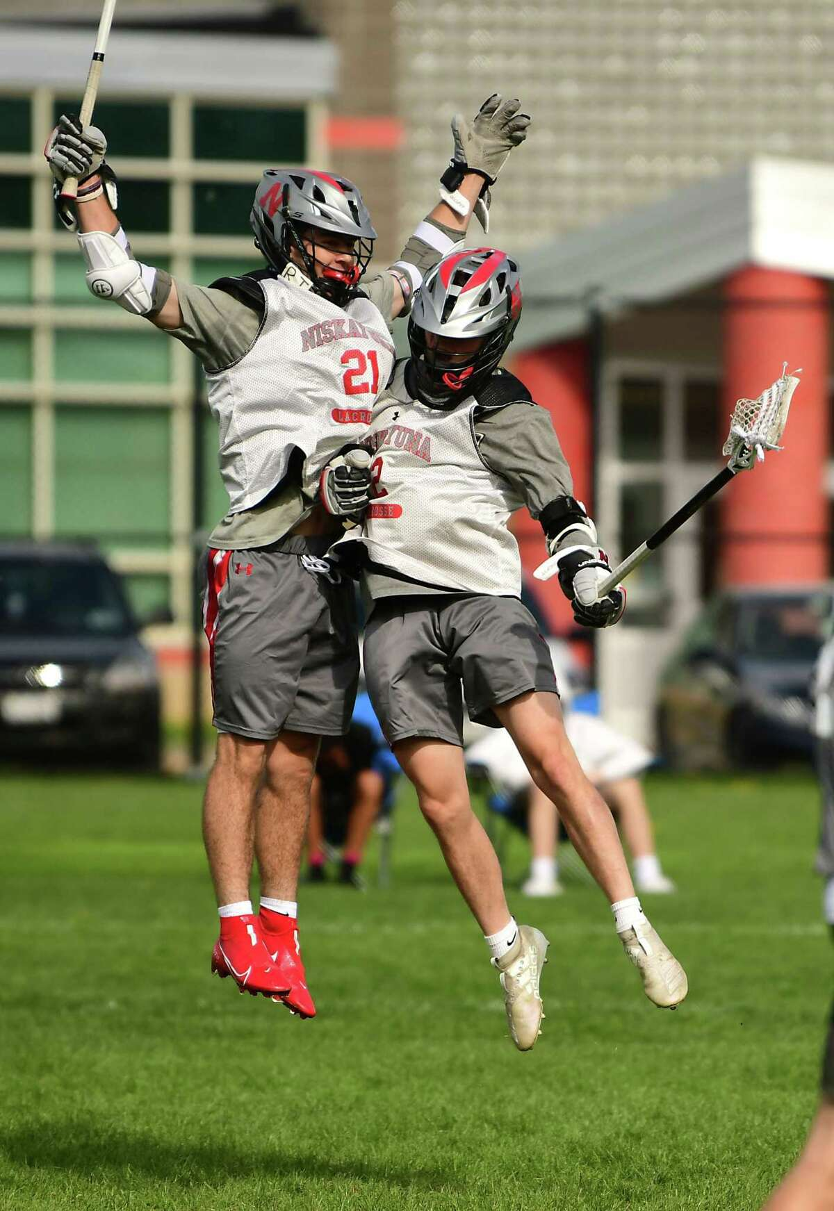 Niskayuna's Brock Behrman, left, celebrates with Cole Nappi after scoring during a lacrosse scrimmage against Shenendehowa on Monday, May 3, 2021 in Niskayuna, N.Y. (Lori Van Buren/Times Union)