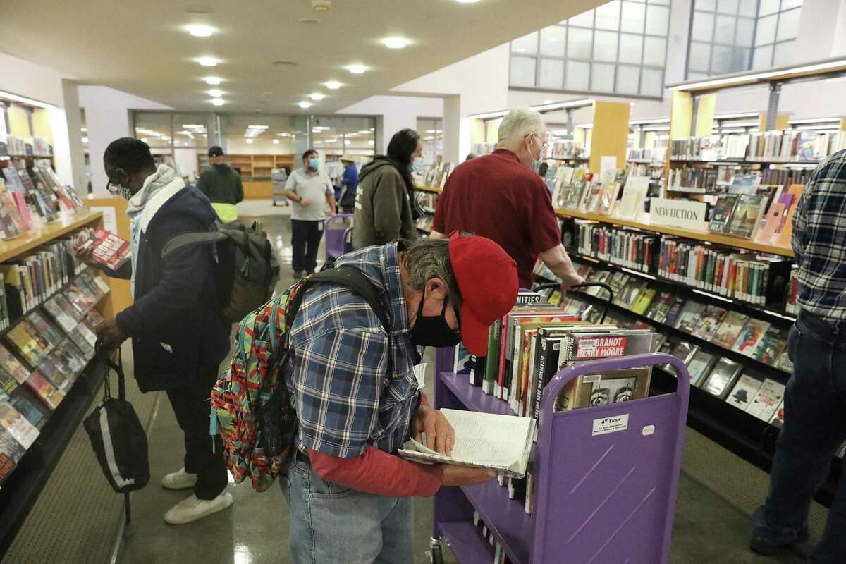 Patrons browse at San Francisco's Main Library after it reopened last month. Most library branches remain closed.