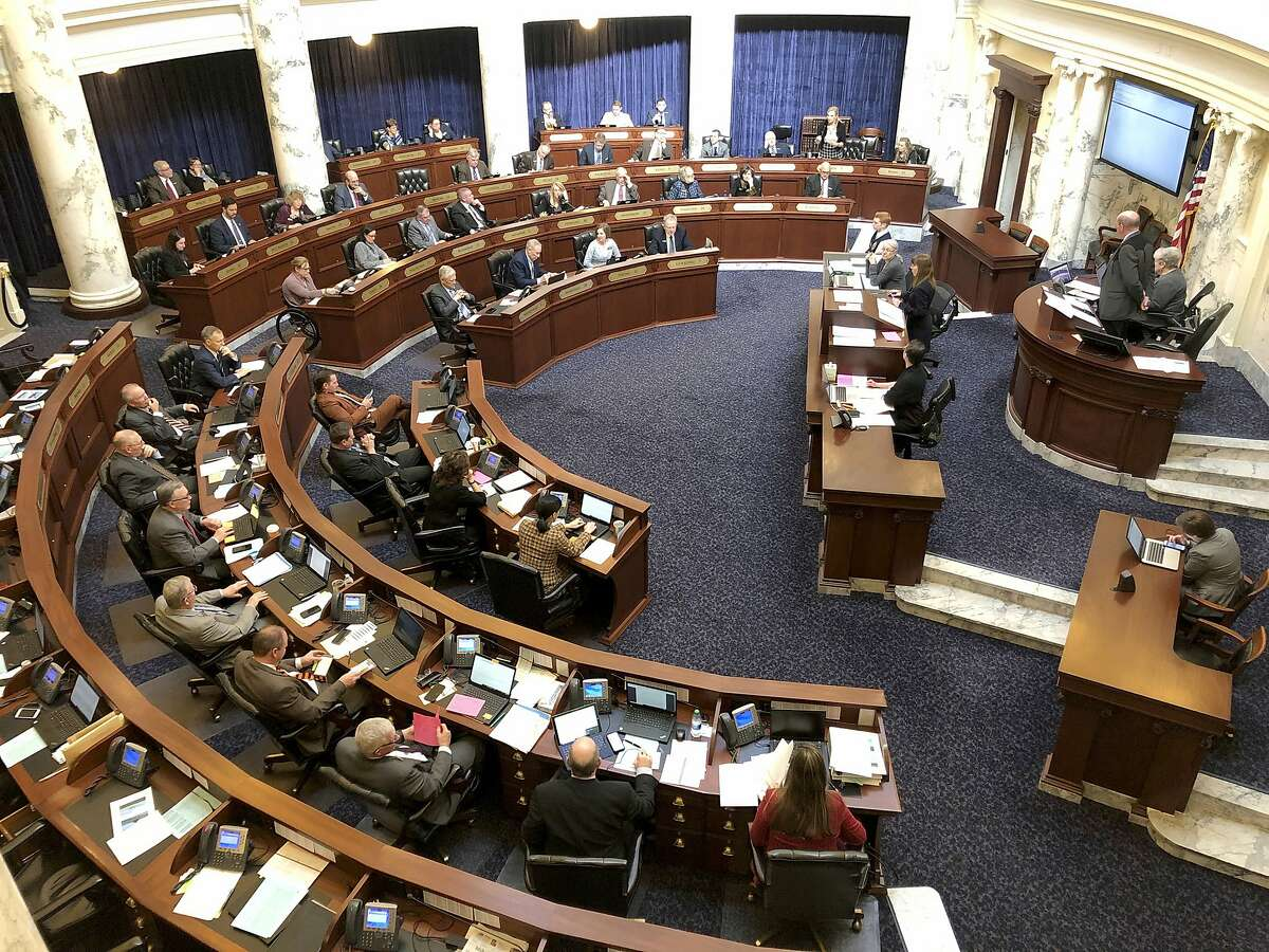 In this Feb. 27, 2020, photo, The Idaho House of Representatives debates legislation in the Idaho Statehouse in Boise in Feb. 2020. The lawmakers passed a law banning transgender females from girls' and women's sports teams, the first law of its kind in the nation. That law is now before the Ninth U.S. Circuit Court of Appeals.