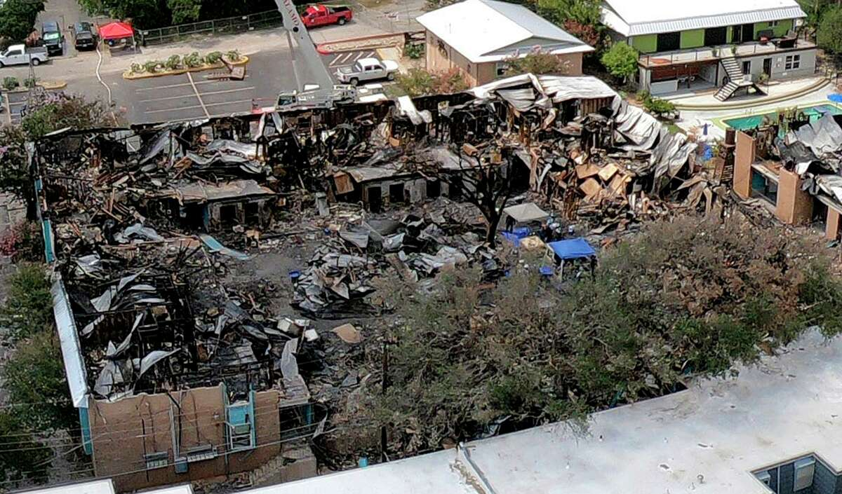 An aerial photograph shows the remnants of a building where five people died after someone deliberately set a fire at Iconic Village Apartments in San Marcos on July 20, 2018. Nearly three years later, the case remains unsolved. No one has been arrested.