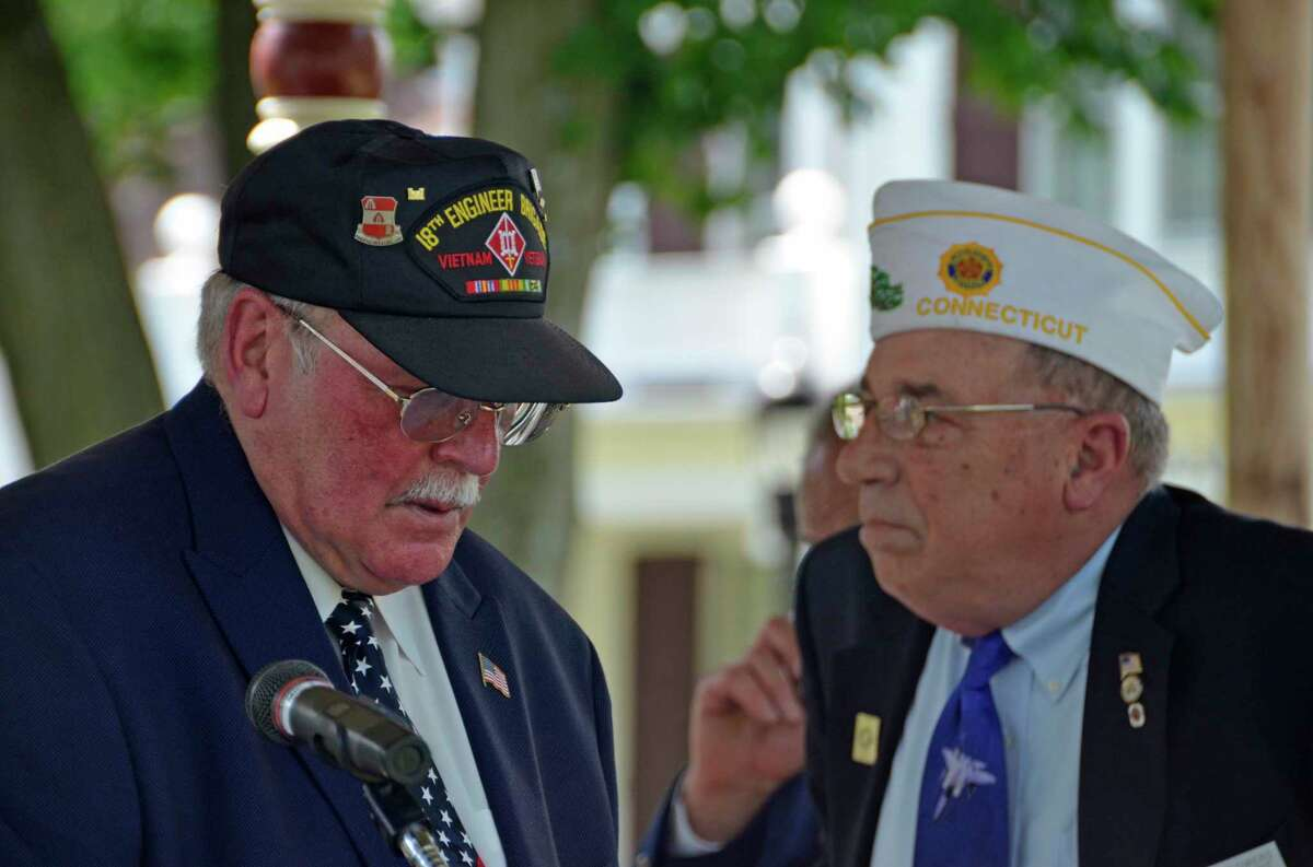 William Cates, left, who was head of Milford's former patriotic organization, MAPO, prepares to introduce Tom Flowers, grand marshal of Milford's 2019 Memorial Day Parade, during a short ceremony following the parade.