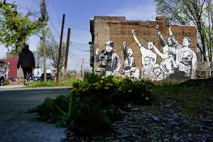 A large mural is seen on the side of a building along Clinton Ave., in the West Hill neighborhood, on Wednesday, April 28, 2021, in Albany, N.Y.   (Paul Buckowski/Times Union)