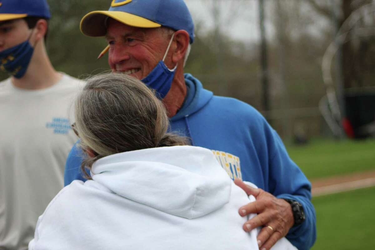 Haddam-Killingworth coach Mark Brookes and wife Rae after Brookes' Cougars beat Old Saybrook for his 700th coaching win Monday.