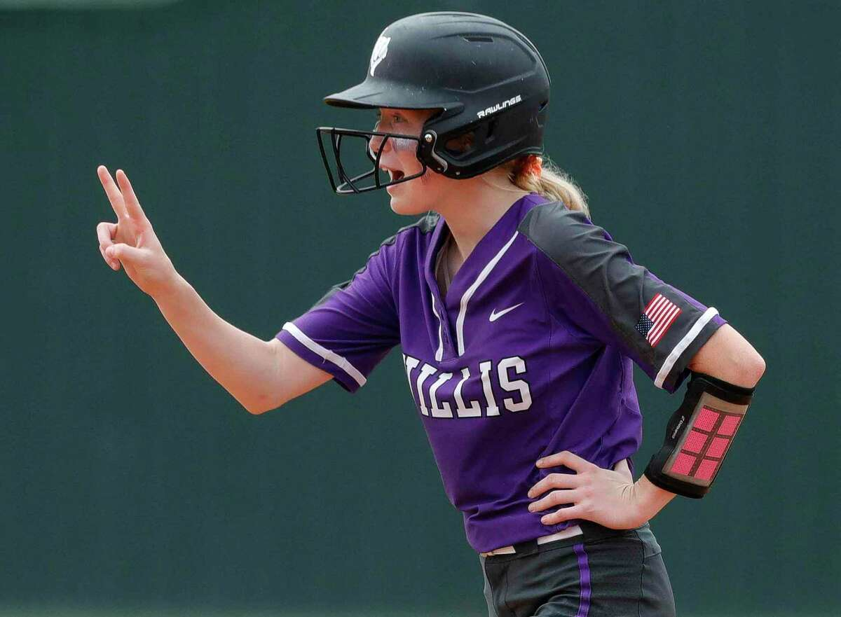 Lana Barnes #9 of Willis gestures toward Kyndal Murphy after advancing to second on her RBI single during the second inning of a Region II-6A bi-district high school softball playoff game at Willis High School, Thursday, April 29, 2021, in Willis.