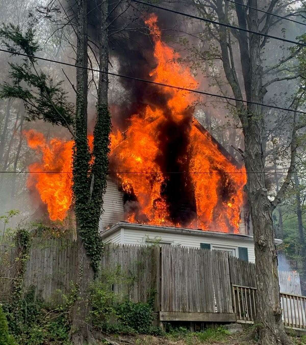 Shelton firefighters battled a blaze at a Long Hill Avenue home on Monday, May 3, 2021.