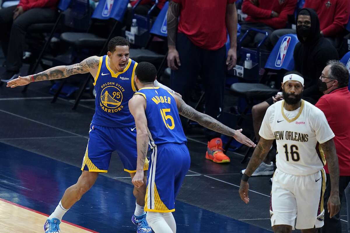 Golden State Warriors guard Mychal Mulder (15) celebrates with forward Juan Toscano-Anderson (95) after his 3-point basket as the shot clock expired, in the second half of an NBA basketball game against the New Orleans Pelicans in New Orleans, Monday, May 3, 2021. (AP Photo/Gerald Herbert)