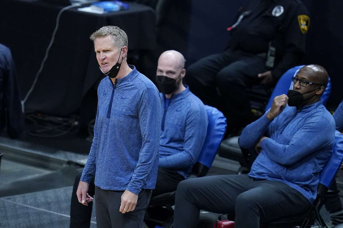 Golden State Warriors head coach Steve Kerr watches from the bench in the second half of an NBA basketball game against the New Orleans Pelicans in New Orleans, Monday, May 3, 2021. The Warriors won 123-108. (AP Photo/Gerald Herbert)
