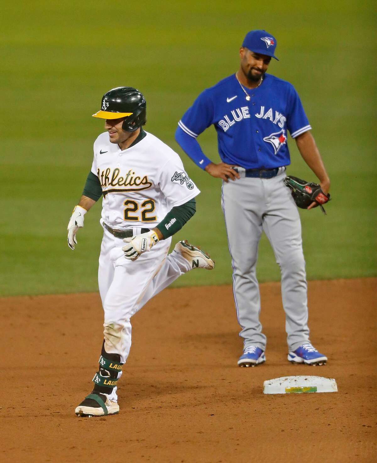 The A's Ramón Laureano passes former teammate Marcus Semien after his two-run homer.