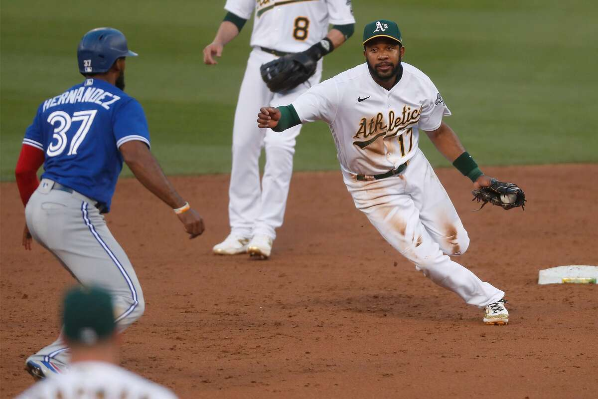 Oakland Athletics' Tony Kemp runs towards Toronto Blue Jays' Teoscar Hernandez to tag him out on 3rd inning fielder's choice during MLB game at Oakland Coliseum in Oakland, Calif., on Monday, May 3, 2021.