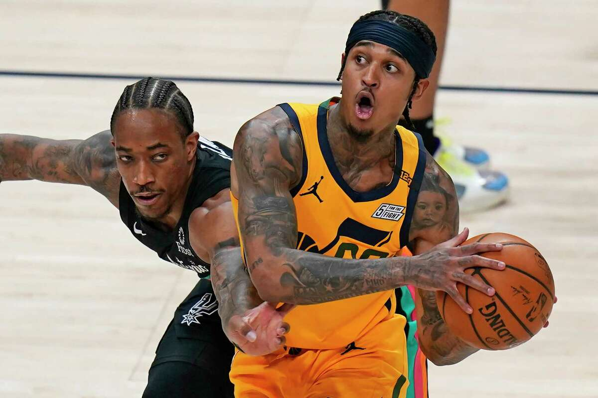 San Antonio Spurs forward DeMar DeRozan, left, guards Utah Jazz guard Jordan Clarkson, right, in the first half during an NBA basketball game Monday, May 3, 2021, in Salt Lake City. (AP Photo/Rick Bowmer)