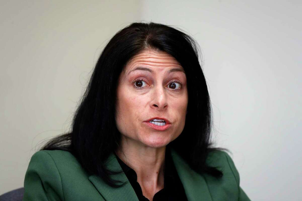 FILE - In this June 4, 2019, file photo, Michigan Attorney General Dana Nessel listens to a question from reporters in Detroit. On Tuesday, Oct. 27, 2020, a judge blocked a sudden ban on the open display of guns near Michigan polling places on Election Day. Gun-rights groups said Secretary of State Jocelyn Benson, a Democrat, had exceeded her authority in banning people from openly carrying guns within 100 feet of polling places. Critics argued that Benson failed to go through a formal rule-making process as required under state law. The judge agreed. Nessel pledged to appeal the judge's decision with just days left until the election. (AP Photo/Paul Sancya, File)
