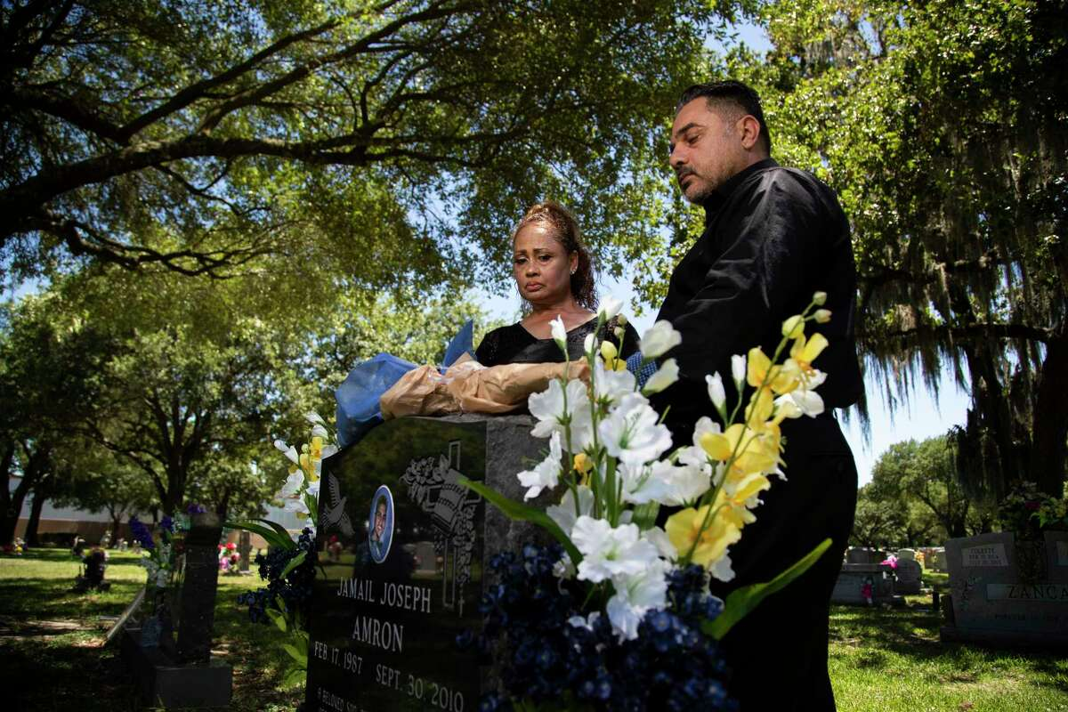 Jamail? Amron's parents Barbara Coats and Ali Amron visit his grave on Thursday, June 11, 2020, in Humble. Jamail? Amron died suddenly following his arrest by Harris County officers in 2010. Jamail Amron, was allegedly beaten by Harris County officers, according to the civil lawsuit originally filed in 2012 against Harris County and Precinct 4 deputy constable Kevin B. Vailes by Amrom's parents.