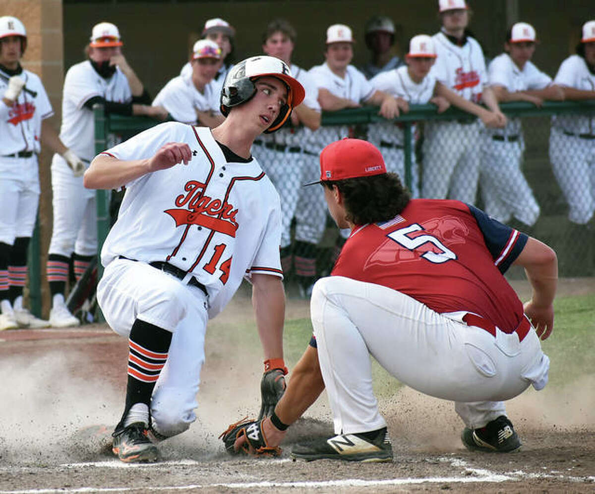 Edwardsville's Kyle Modrusic slides safely into home plate ahead of the tag against Wentzville (Mo.) Liberty on Monday at Tom Pile Field in Edwardsville.