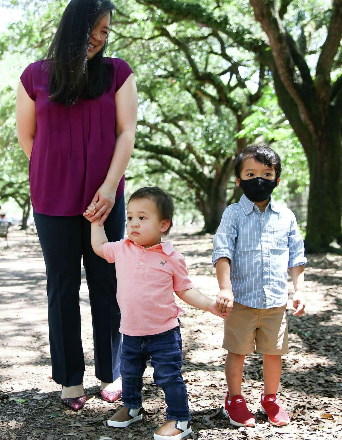 Dr. Thao Galvan with her sons 16-month-old Nathan and Charlie, 3, in Houston on Sunday, May 2, 2021. Galvan enrolled her son in part of the under-2 group Pfizer trial.